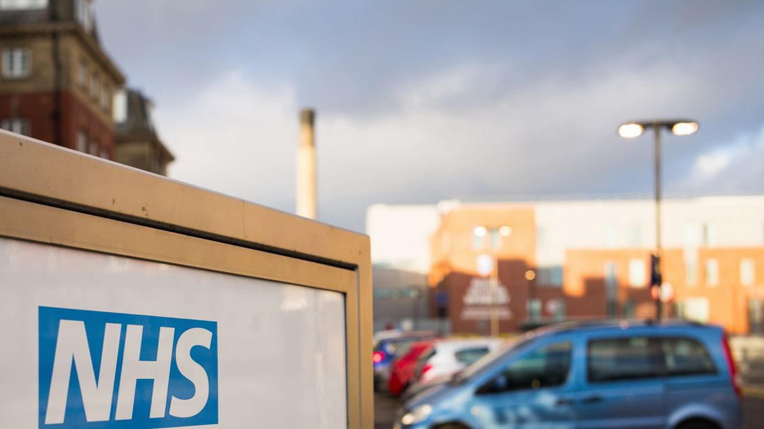 Newcastle, UK - February 10, 2016: The NHS (National Health Service) logo on an entrance sign for the Royal Victoria Infirmary, a teaching hospital which includes an accident and emergency department...Part of an NHS hospital entrance sign in Newcastle, England.