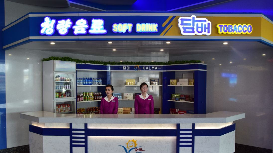 Women at a kiosk in Wonsan Airport, North Korea. Pic: Michael Greenfield