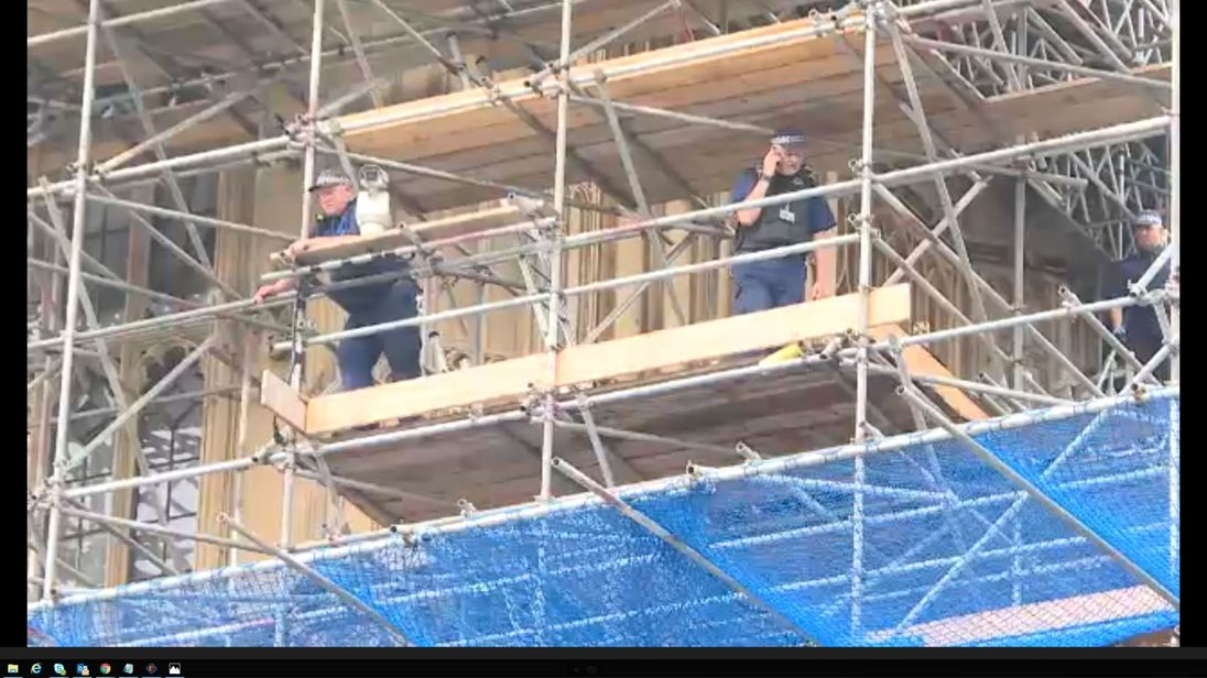 Police were seen on Parliament's scaffolding after the arrest