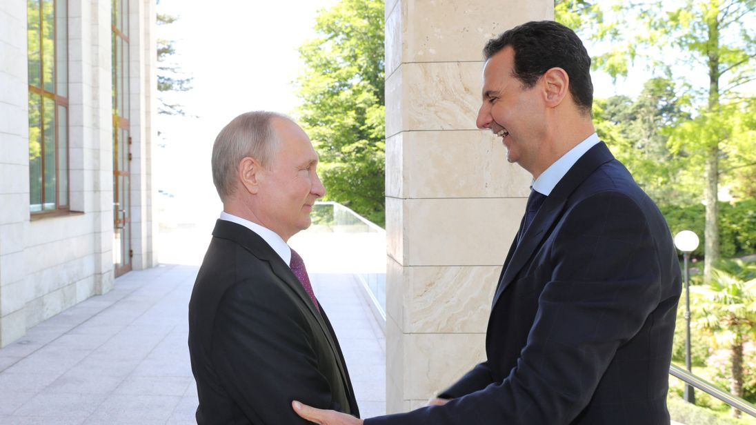 Vladimir Putin welcomes Syrian President Bashar al-Assad during their meeting in the Black Sea resort of Sochi, Russia