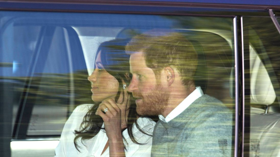 Prince Harry and Meghan Markle leave Kensington Palace as they head to Windsor for wedding rehearsals