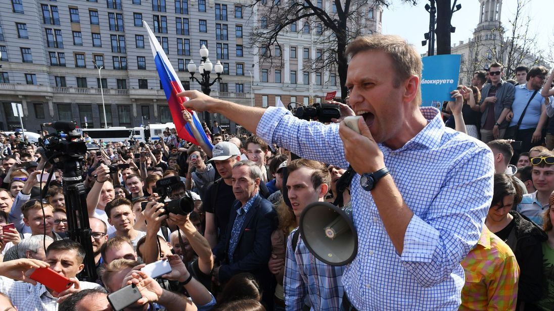 Russian opposition leader Alexei Navalny addresses supporters during an unauthorised anti-Putin rally