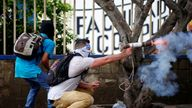 A demonstrator fires a homemade mortar towards riot police during a protest against Nicaragua's government in Managua, Nicaragua