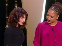 Asia Argento has warned 'we know who your are' to a Cannes audience over abuse of actresses.