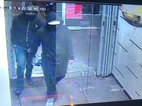 Police tweeted this image of the suspects walking into the restaurant
