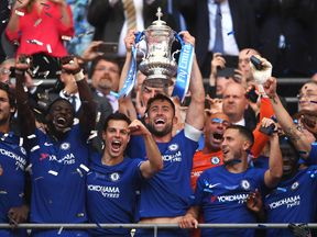 Chelsea captain Gary Cahill lifts the FA Cup after his side beat Manchester United 1-0