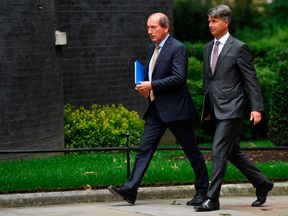 Nestle chairman Paul Bulcke and BMW boss Harald Kruger arrive in Downing St