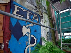 Old graffiti of the ETA logo in the village of Bermeo, northern Spain