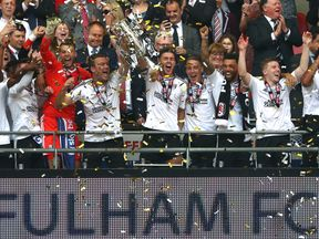 Fulham celebrate winning the biggest financial prize in world football