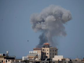 Smoke rises following an Israeli air strike in Gaza May 29, 2018. REUTERS/Suhaib Salem