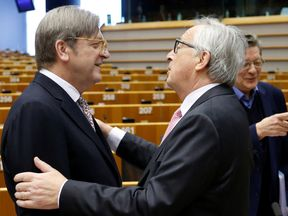 Guy Verhofstadt and Jean-Claude Juncker take part in a plenary session at the European Parliament in Brussels