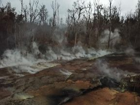 Sulphur dioxide plumes drift out of the lava-charred land on Hawaii's Big Island