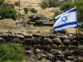 An Israeli tank can be seen near the Israeli side of the border with Syria in the Israeli-occupied Golan Heights, Israel May 9, 2018