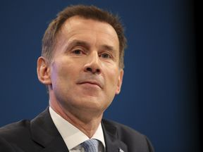 Health Secretary Jeremy Hunt delivers his keynote speech on the third day of the Conservative Party annual conference at the Manchester Central Convention Centre in Manchester on October 3, 2017 in Manchester, England. Foreign Secretary Boris Johnson is due to make his keynote conference speech later today amid widespread speculation of a leadership challenge.