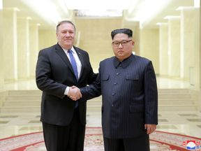North Korean leader Kim Jong Un shakes hands with US Secretary of State Mike Pompeo