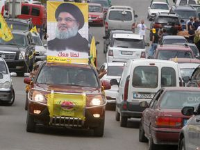 A poster of Hezbollah leader Sayyed Hassan Nasrallah on top of a car