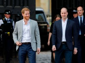 Harry and William emerge from Windsor Castle