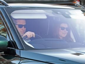 Prince William and Kate Middleton were wearing dark glasses as they returned home for last night's royal wedding reception