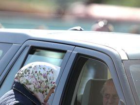 Queen Elizabeth II talking to the Duke of Edinburgh during the Royal Windsor Horse Show at Windsor Castle, Berkshire
