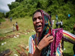 A Hindu villager looks on at the site of an alleged mass grave in Myanmar's Rakhine state