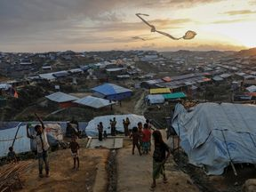 Refugees are seen at the Cox's Bazar refugee camp in Bangladesh, near Rakhine state, Myanmar, during...