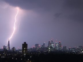 A streak of lightning illuminates London's Shard. Pic. Matthew Smith