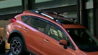 Porsche parked under SUV by valet in Sydney