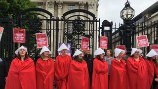 Protesters in costumes similar to those in TV drama The Handmaid's Tale