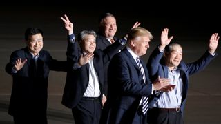 The three Americans formerly held hostage in North Korea gesture next to U.S.President Donald Trump and Secretary of State Mike Pompeo