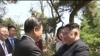 Kim Jong Un and Xi Jinping meet in China