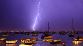 Lightning strikes over Poole Harbour during a thunderstorm on July 21, 2013 in Poole, England. The spell of hot weather was brought to an end last night on the South coast after a second week of heatwave conditions across the UK.