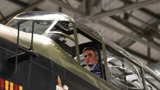 Defence Secretary Gavin Williamson looks out of the cockpit of an Avro Lancaster bomber during a visit to RAF Coningsby, where he announced that the multi million pound F-35 stealth fighter jets will start arriving at RAF Marham, Norfolk, early next month.