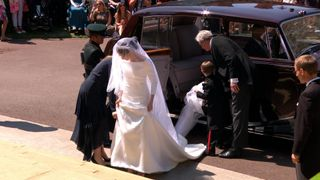 The bride, Meghan Markle, emerges