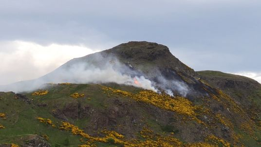 A wildfire which has spread across Arthur's Seat in Edinburgh and is being tackled by around 30 firefighters