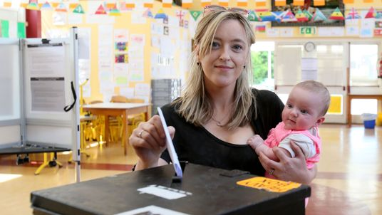 Niamh Gavin poses for a photograph with her 5-year-old daughter Fiadh as she casts her vote in the Irish referendum on liberalising abortion law, at St Paul's National school in Athlone, Ireland on May 25, 2018