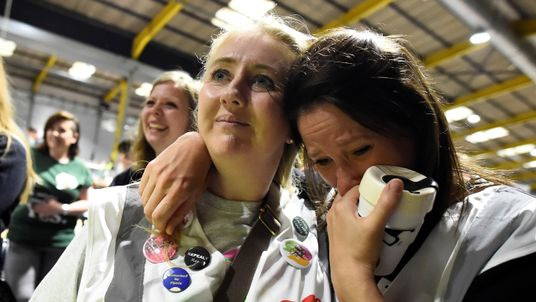 Voters listen to the results of an exit poll as counting begins in Dublin
