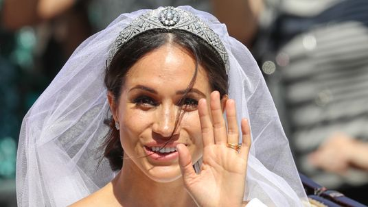 Meghan, the Duchess of Sussex, waves from the carriage during the procession after royal wedding at Windsor