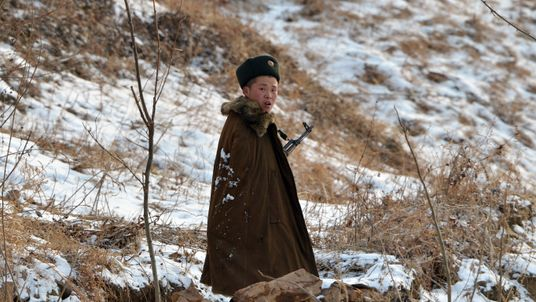 A North Korean soldier patrols along the Yalu River near the North Korean town of Sinuiju after the country conducted it's third nuclear test on February 12, 2013