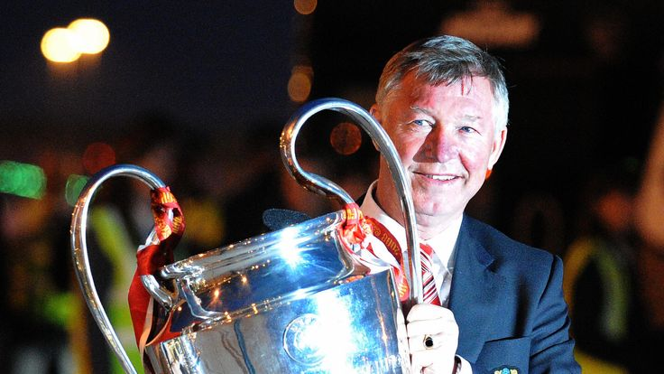 Manchester United manager Alex Ferguson holds the Champions League trophy on May 22, 2008 as he returns to Manchester Airport from Moscow after beating Chelsea on May 21 in the UEFA Champions league final, Manchester north-west England