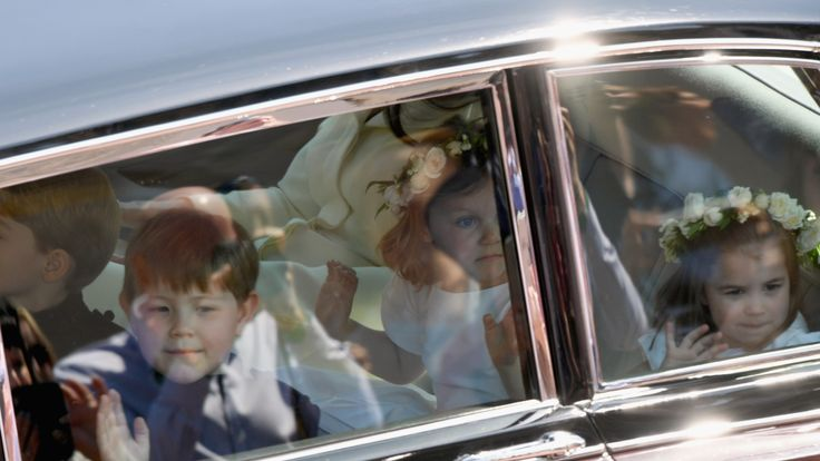 Prince Harry Duke of Sussex and Meghan Duchess of Sussex leave Windsor Castle in the Ascot Landau carriage during a procession after getting married at St Georges Chapel