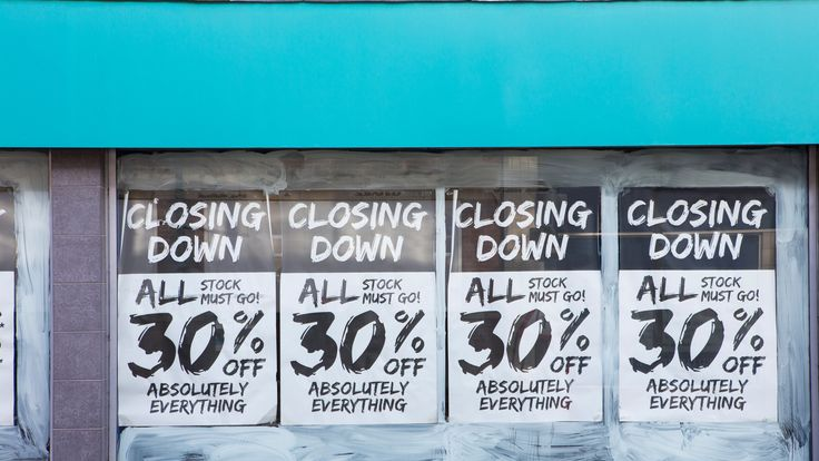 Exterior Of Shop With Closing Down Notice In Window