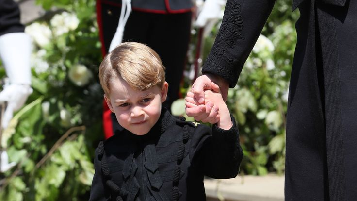 Prince George on the steps of St George's Chapel in Windsor Castle after the wedding of Prince Harry and Meghan Markle. PRESS ASSOCIATION