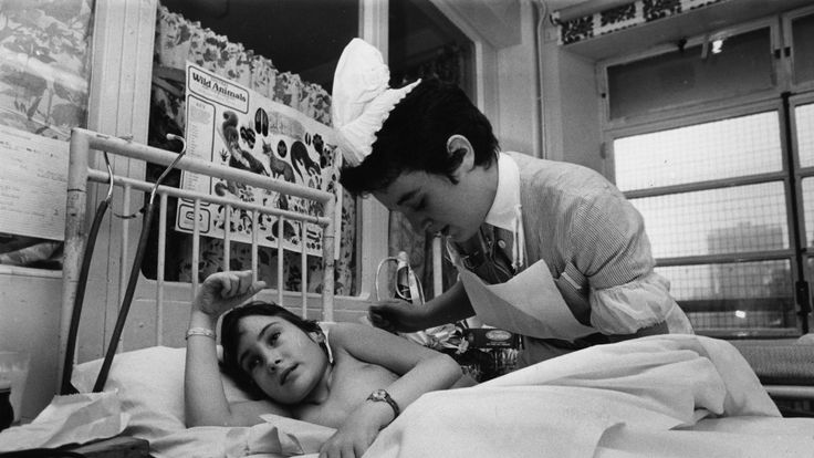 Staff Nurse Rowena Joseph tending a young patient at Great Ormond Street Hospital in 1979