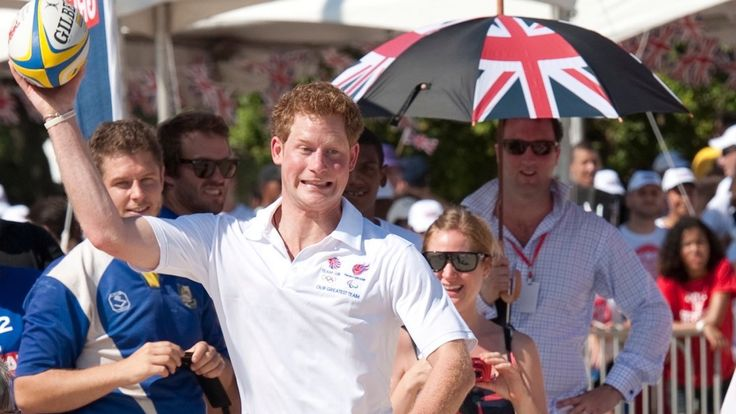 Prince Harry shows off his rugby skills as Paul watches on