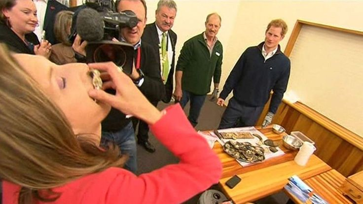 Rhiannon Mills necks a oyster at Prince Harry's request