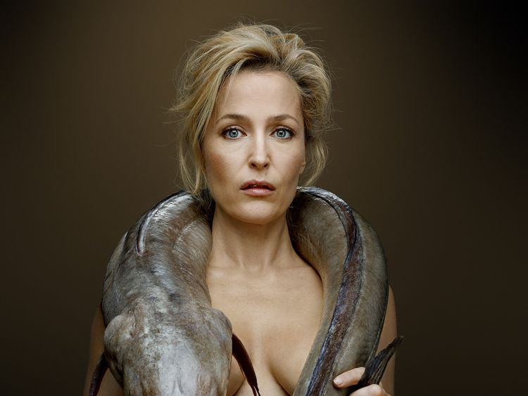 Gillian Anderson with a Conger Eel. Pic: Fishlove/ Denis Rouvre