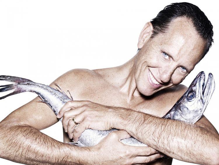 Richard E Grant cuddling a hake. Pic: Fishlove/Rankin