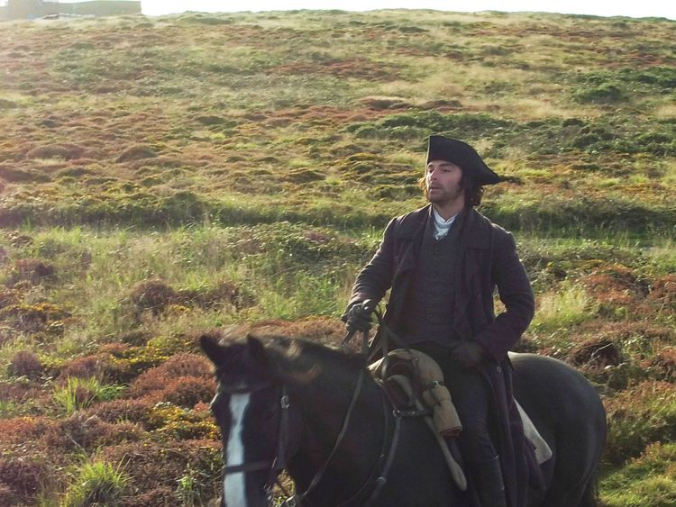 Poldark star Aidan Turner during filming at Gwennap Head on the Cornish coast