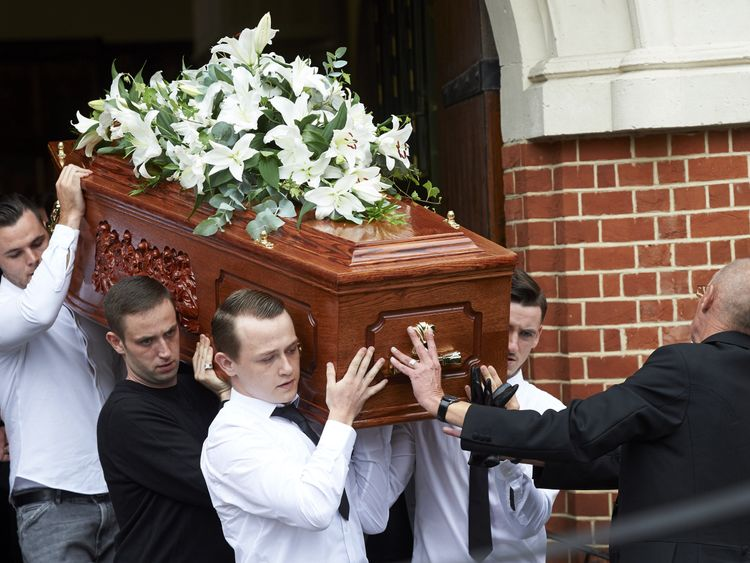 The coffin of Anthony Disson is carried by pallbearers at his funeral on 29 June 2017