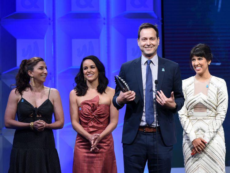 Chelsea Peretti, Melissa Fumero, Dan Fogelman and Stephanie Beatriz accept the Outstanding Comedy Series award for Brooklyn Nine-Nine at the 2018 GLAAD Media Awards